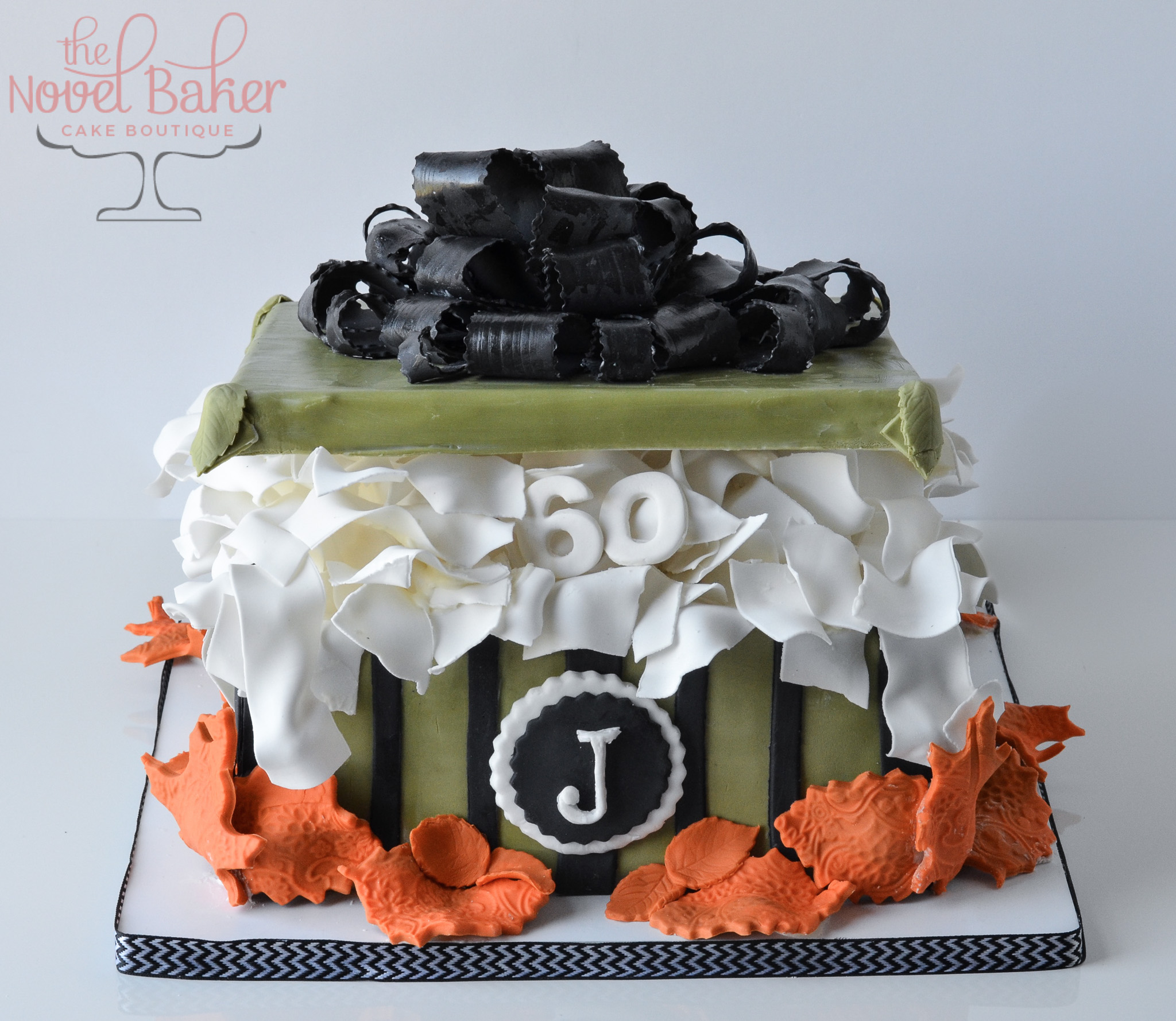 Fall Colors of Olive, Black and Orange embrace this Gift Box Cake