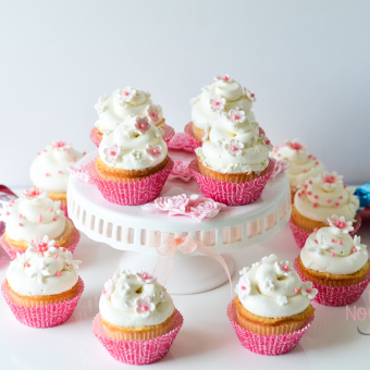 White Flowers on White Icing with pink floral liners