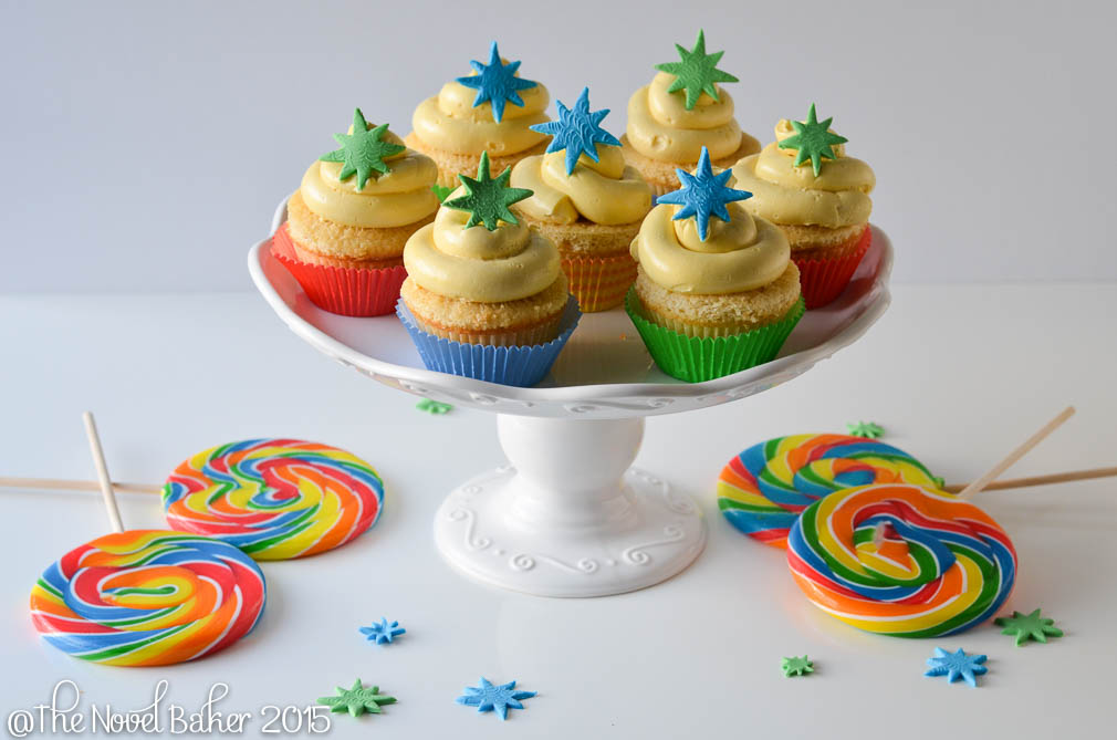 Yellow Cupcakes with Blue and Green stars, red, blue, green liners
