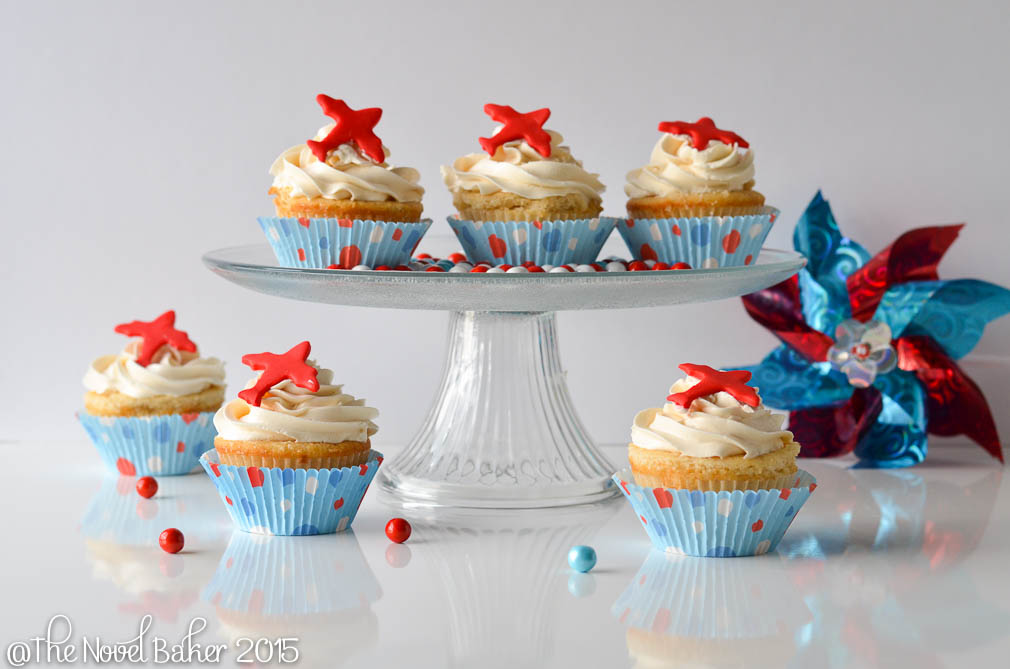 Vanilla Cupcakes  topped with red planes in Light Blue liners with red,white and blue dots