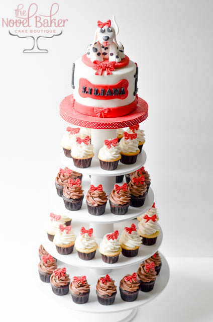 Cupcake Tower with 3D Dalmatian Puppy Topper Cake in Red, White, and Black. Mini Cupcakes with mini red bows.