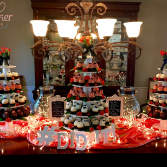 Roses and Ribbons top an Orange and Black Graduate Cupcake Tower