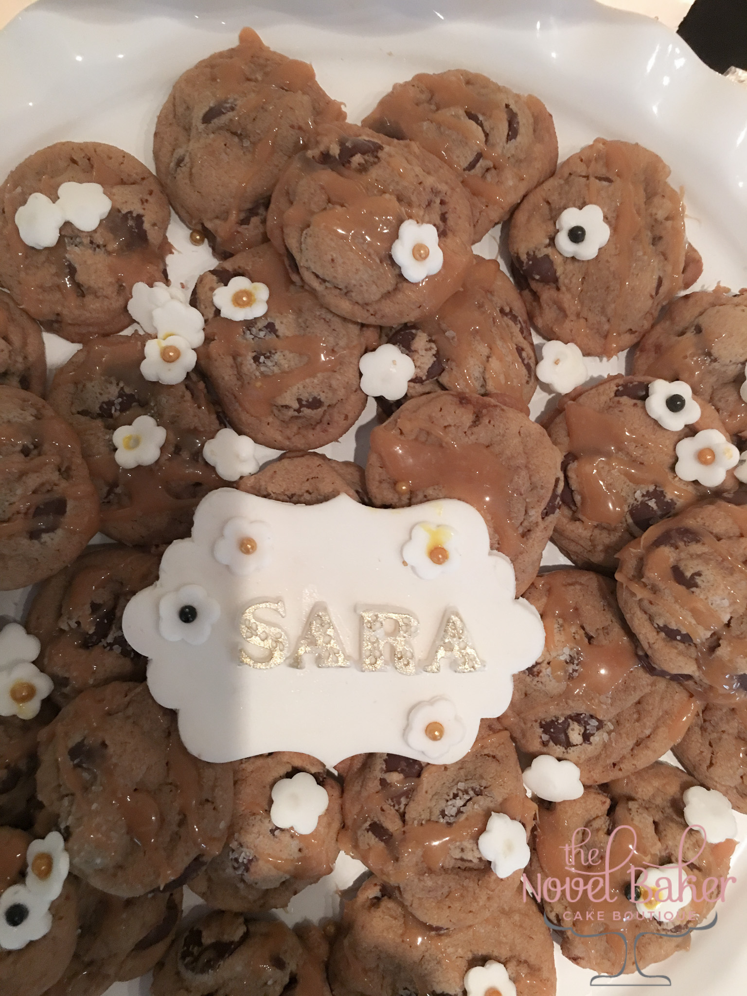 "(187) Choc.Chip Cookies with salted caramel, white fondant flowers, ""SARA"" fondant name plaque"
