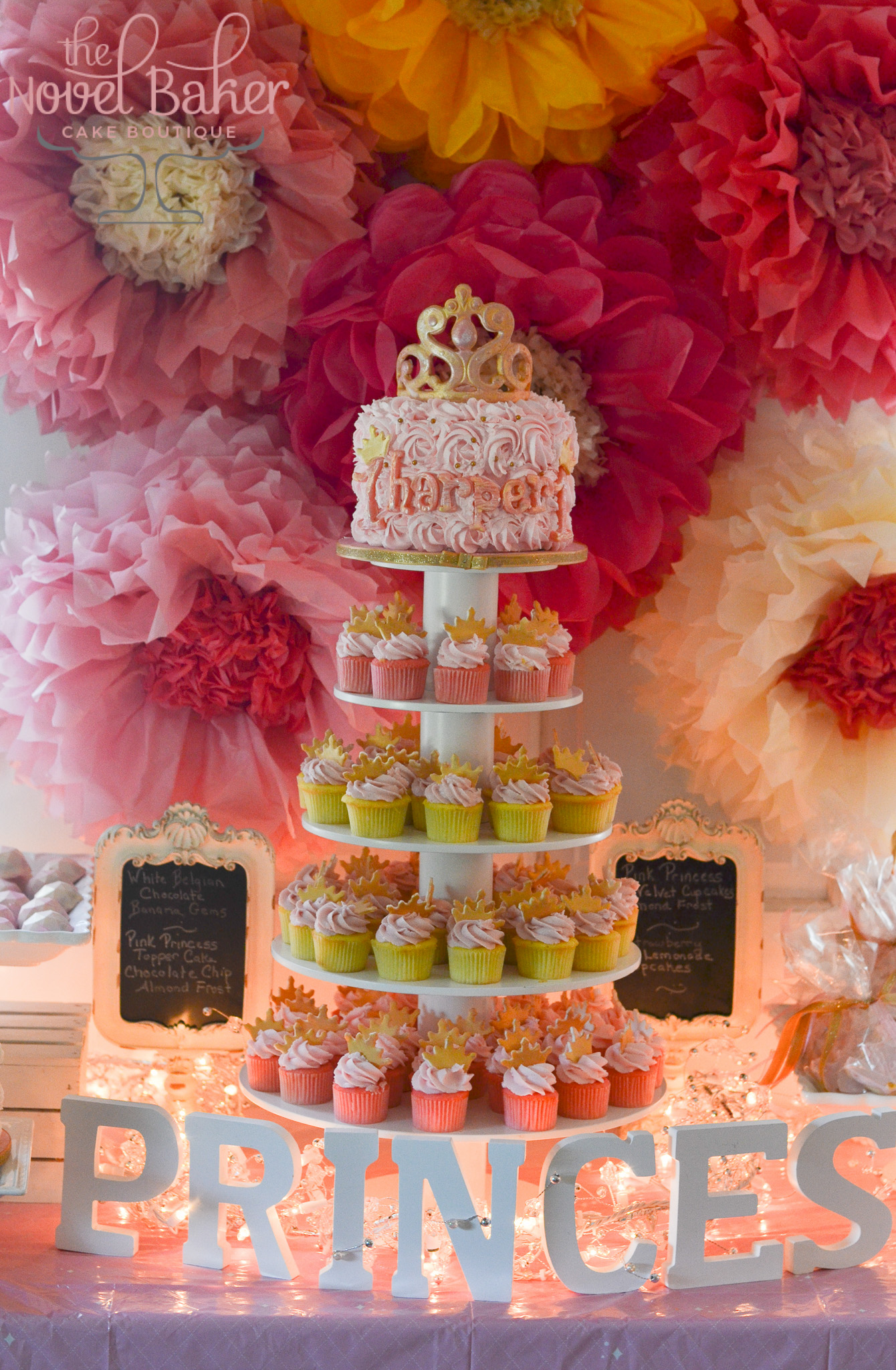 5 Tier Cupcake tower filled with pink minis topped with gold crowns and a top tier Princess cake of pink rosettes, pearl centers, and a gold rubbed tiara.