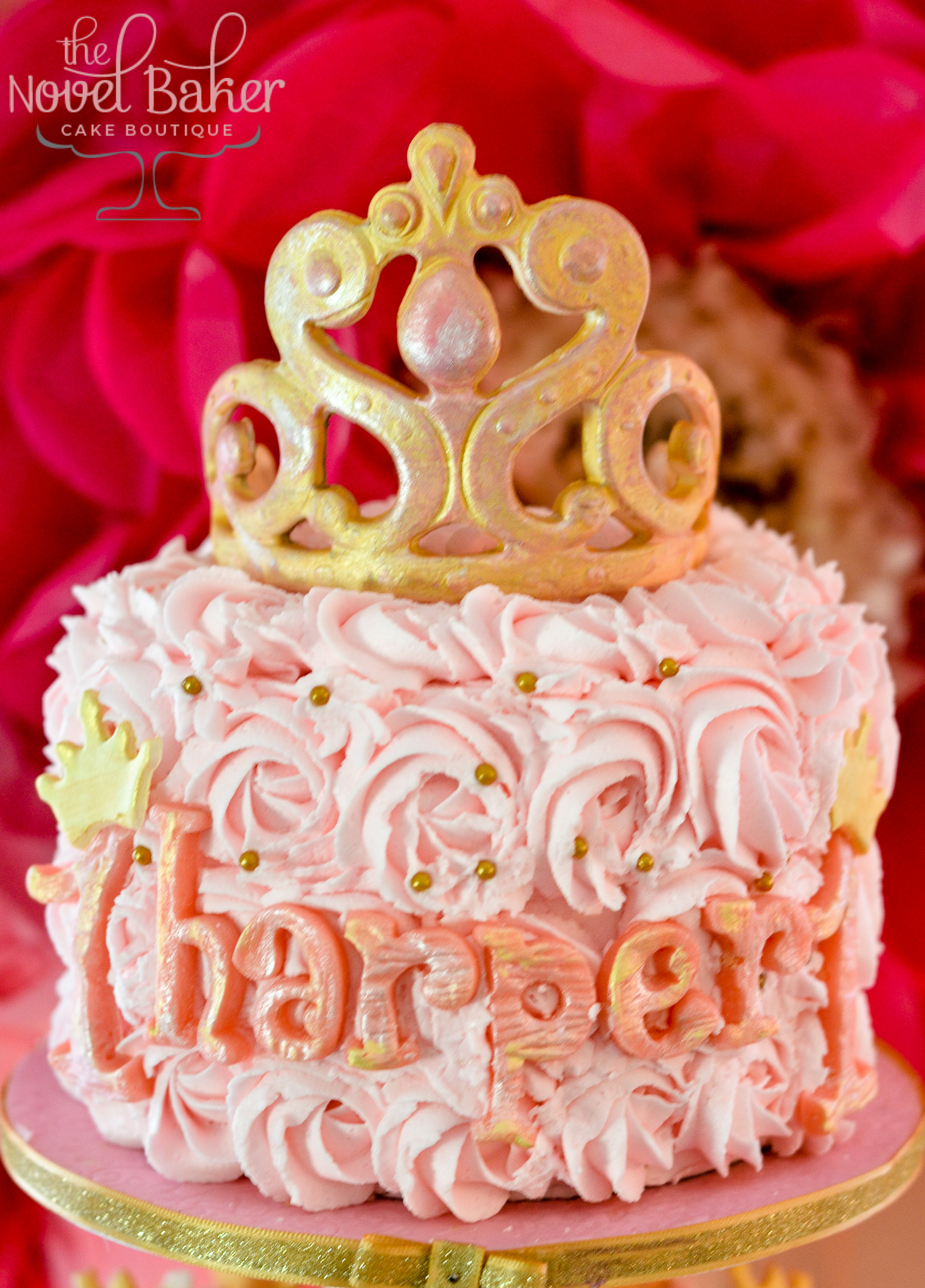 Topper Princess cake of pink rosettes, pearl center and a gold rubbed tiara.