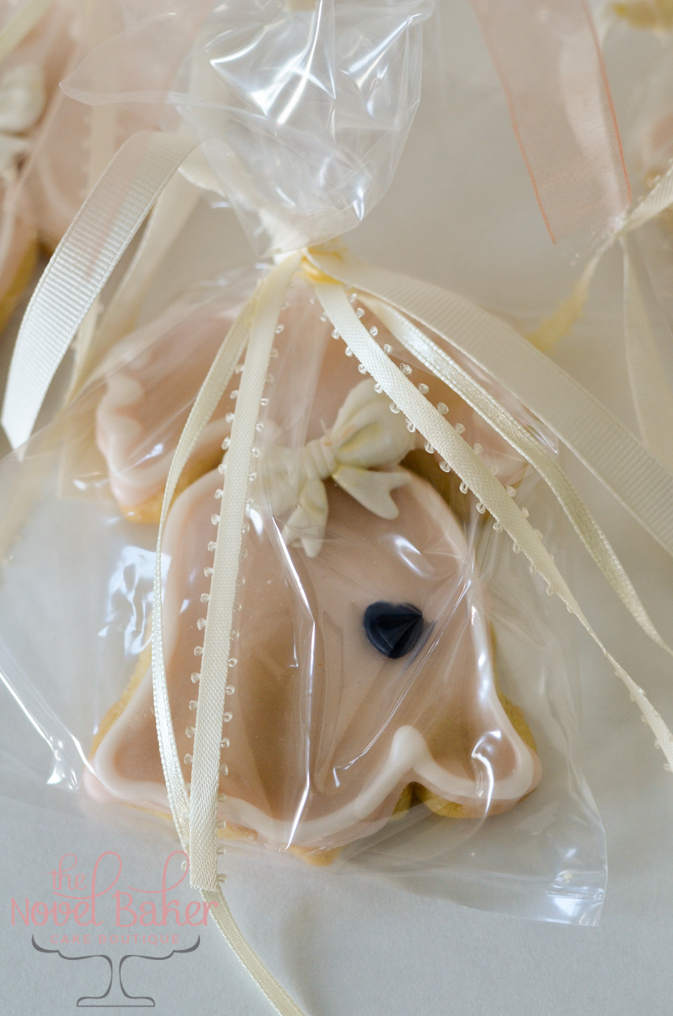 Liberty Bell Cookies in blush with tiny navy heart, ivory trim and bow, bagged and tied with ivory ribbons