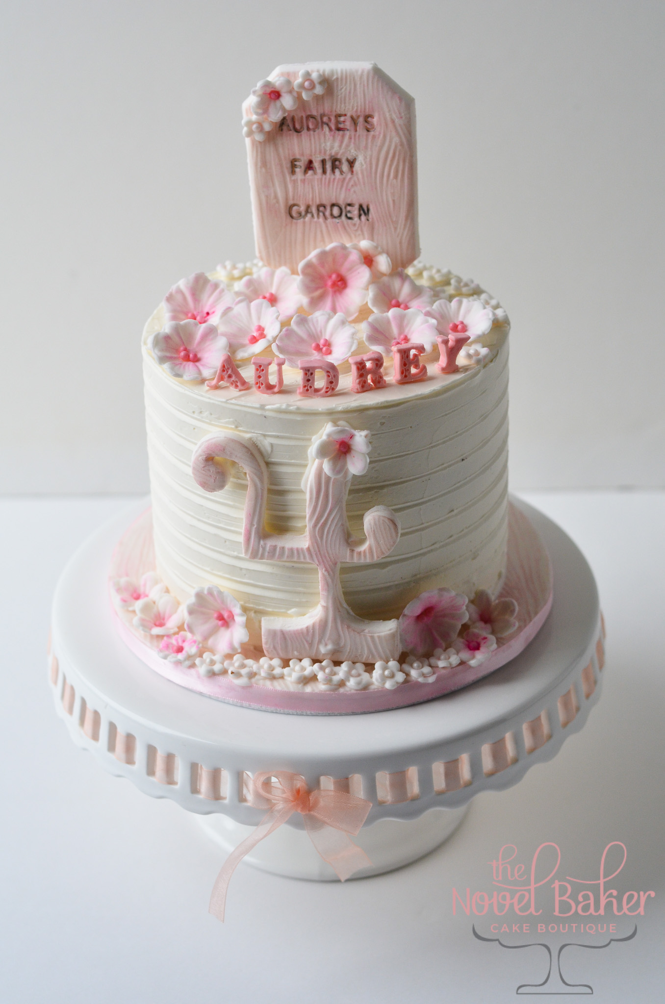 "Fairy Garden Cake: White Buttercream with Pink ""4"" pink and white flowers, fondant Fairy Garden Topper Plaque"