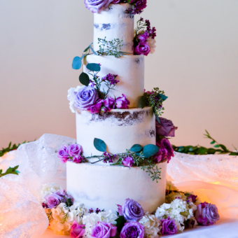Four Tier Semi-Naked Cake with Fresh roses in pinks and lavenders with greens