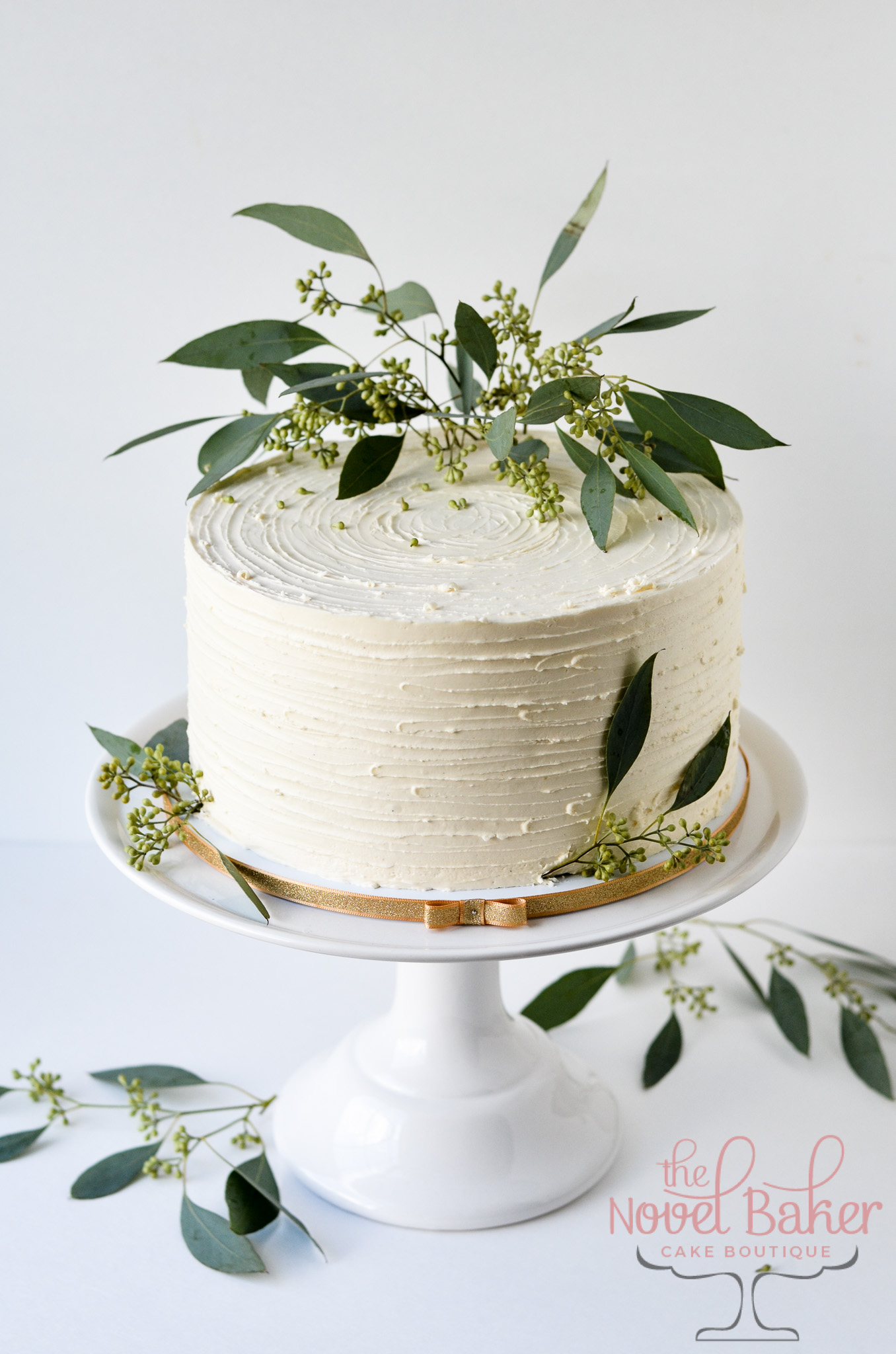Fresh Eucalyptus tops a white rustic buttercream single tier beauty