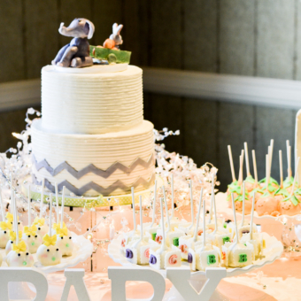 Two tier white buttercream chevron cake with Baby Elephant cake topper, baby face cakepops, babyblock cakepops, pumpkin face cakepops