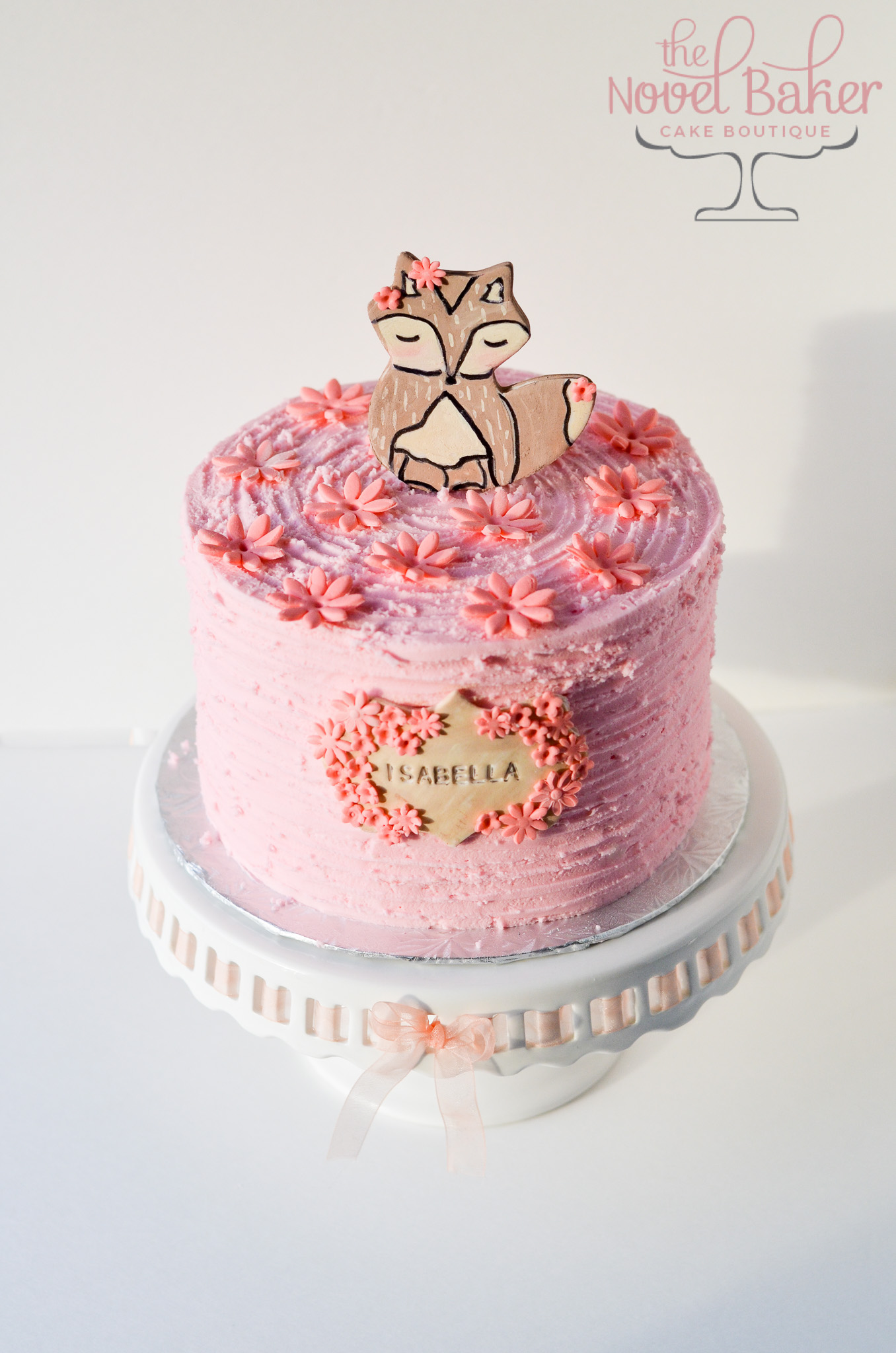 Pink Rustic Buttercream with Hand Painted Foxy Topper, Textured Name Plaque, accented with dark pink fondant daisies.