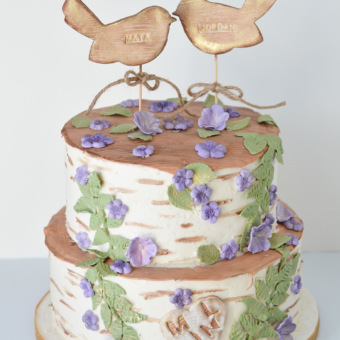 Birch Cake in two tiers of buttercream with wooden bird toppers