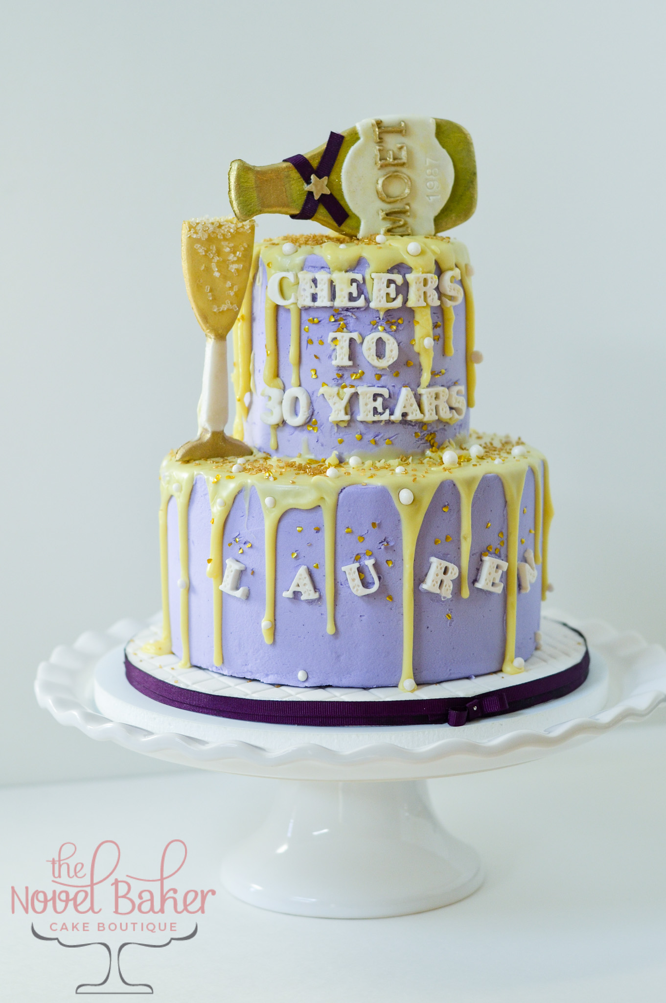"Lavender 2 Tier Buttercream with yellow Champagne Drip Cake. Moet Bottle topper, champagne glass ""Cheers to 30 Years"""