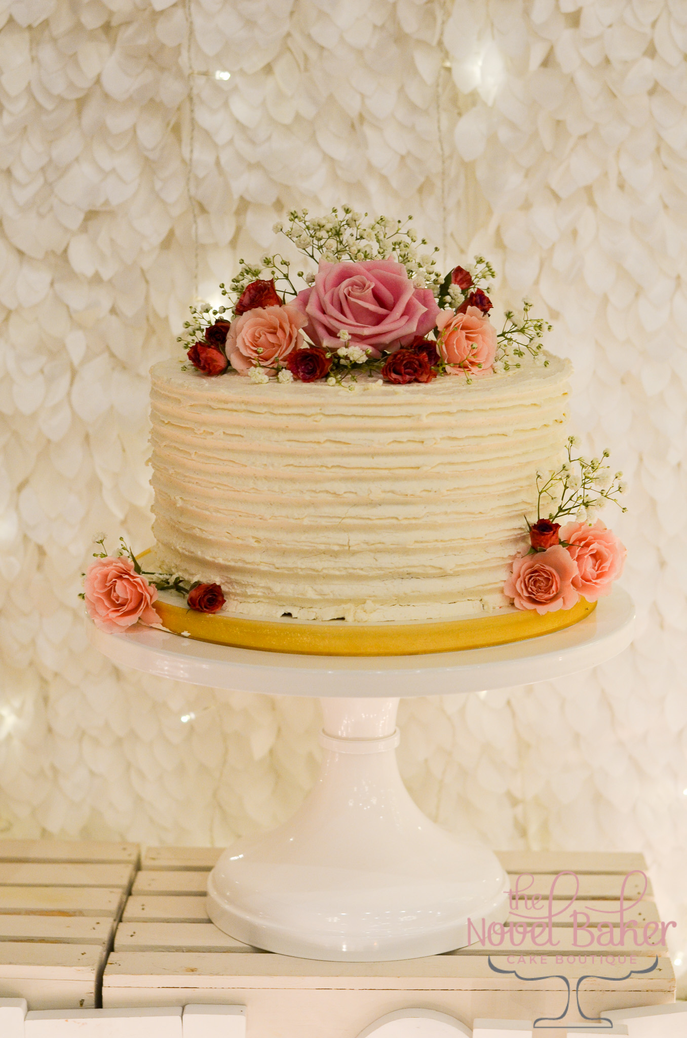 Buttercream Cake with pink sweetheart roses and baby's breath