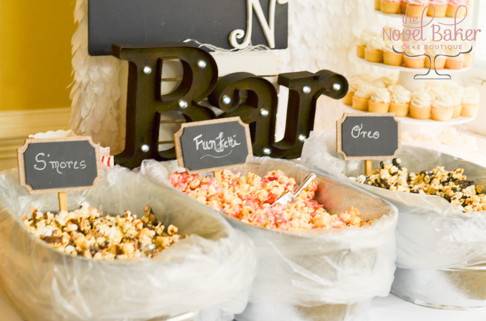 White chocolate drizzled caramel corn with toppings