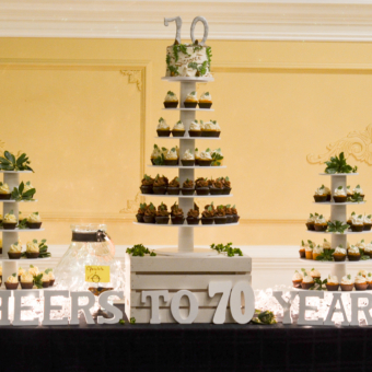 Cupcakes topped with fondant leaves and towers topped with real greens. Cheers to 70 Years!