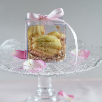 Lemon Madeleines in a pink ribbon tied clear favor box