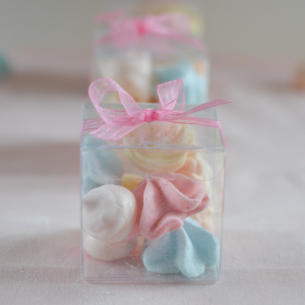 Meringues in Mini Clear Favor Boxes tied with pink ribbons