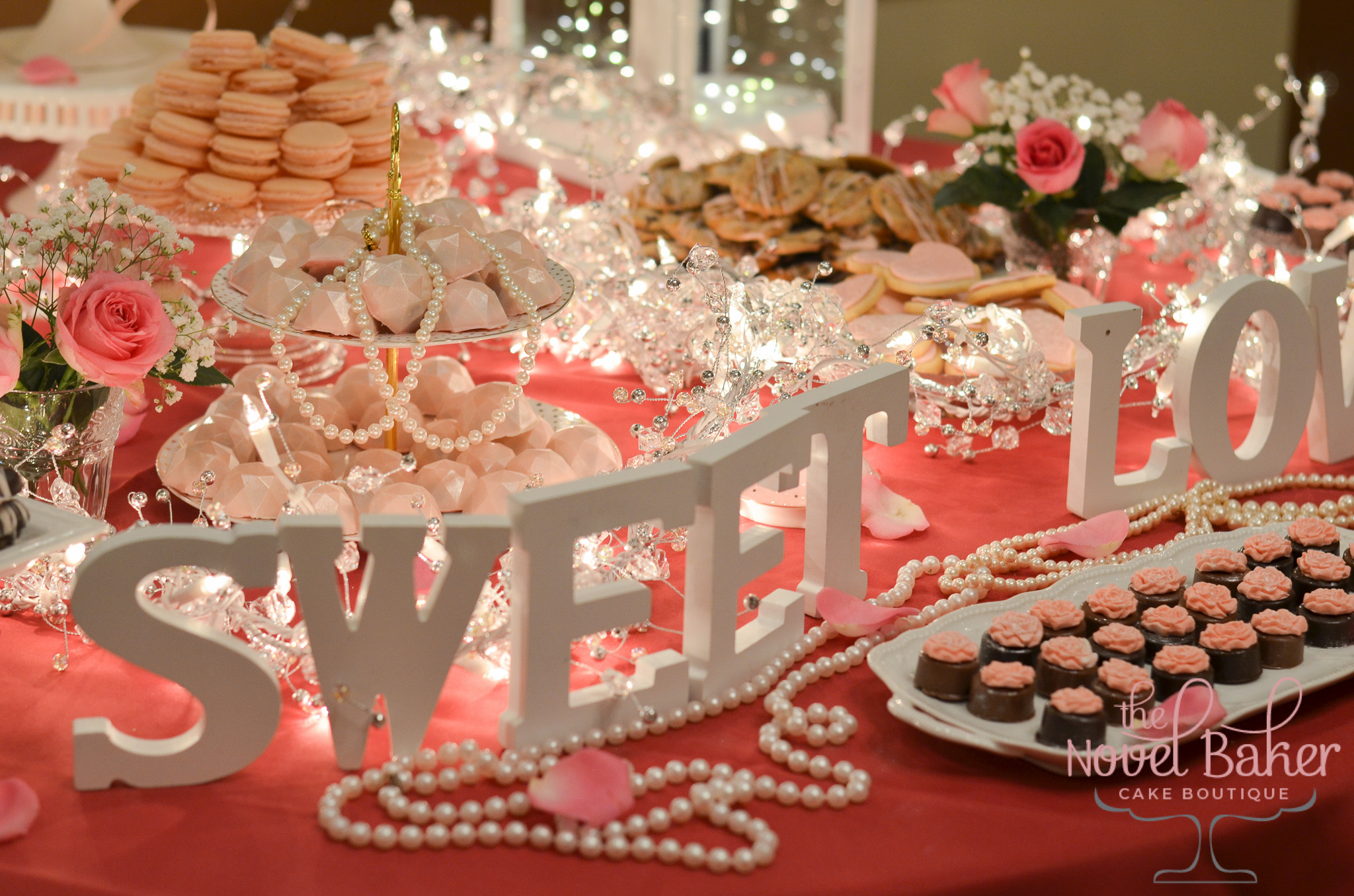 Tea Party Table with Delicate and Dreamy Cookies, Macarons, Pretzels, and Chocolates in blush and white.