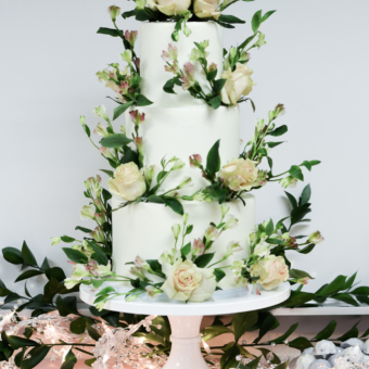 White Three Tier Buttercream with cream roses and flowers