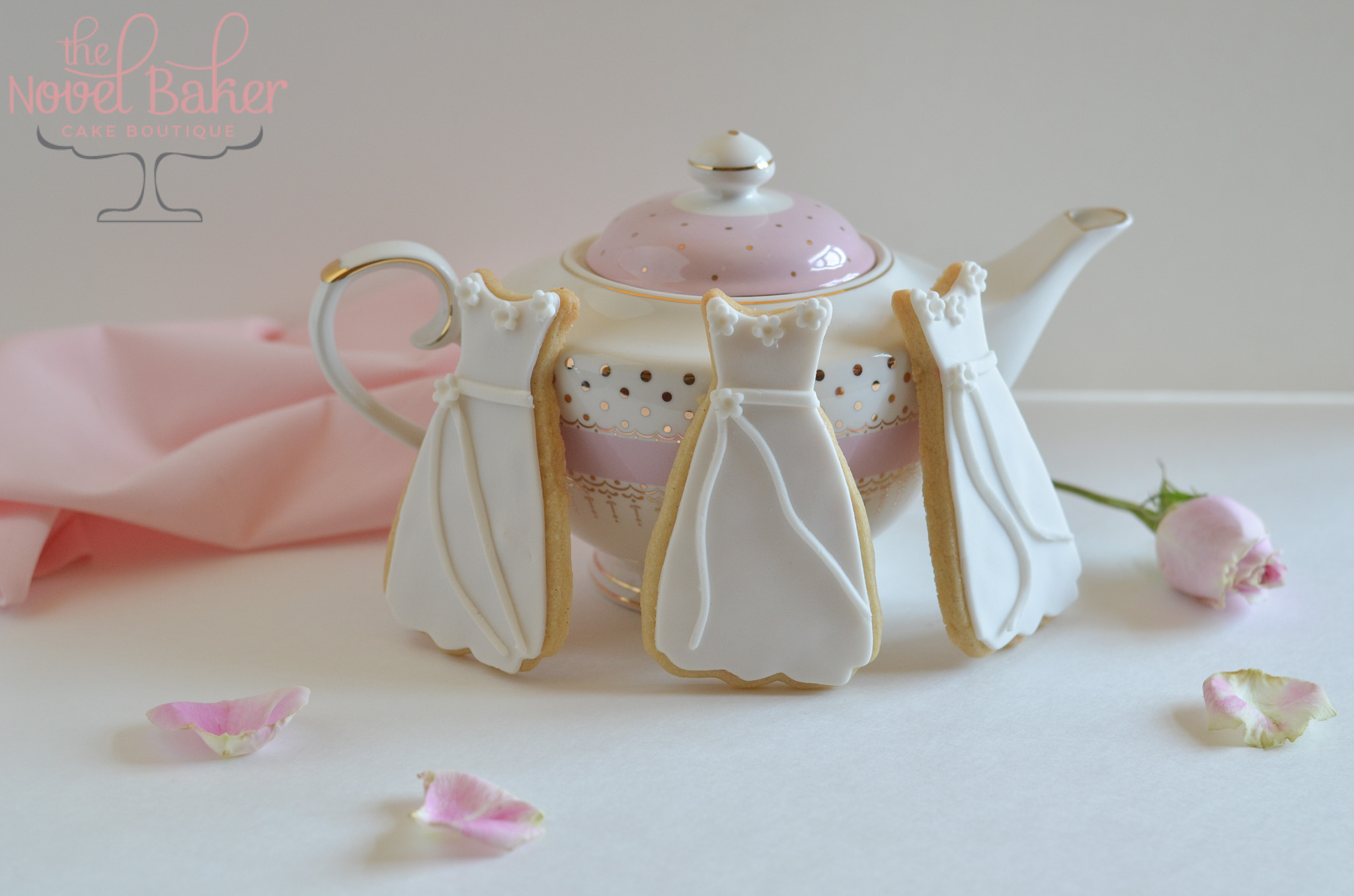 Shortbread cookies with white fondant dresses. Deliciously perfect for Bridal Shower Favors!