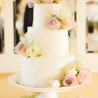 Three-tier buttercream with fresh roses